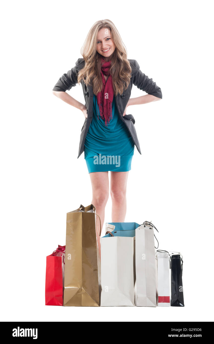 Shopping lady expressing confidence surrounded by shopping bags - Stock Image