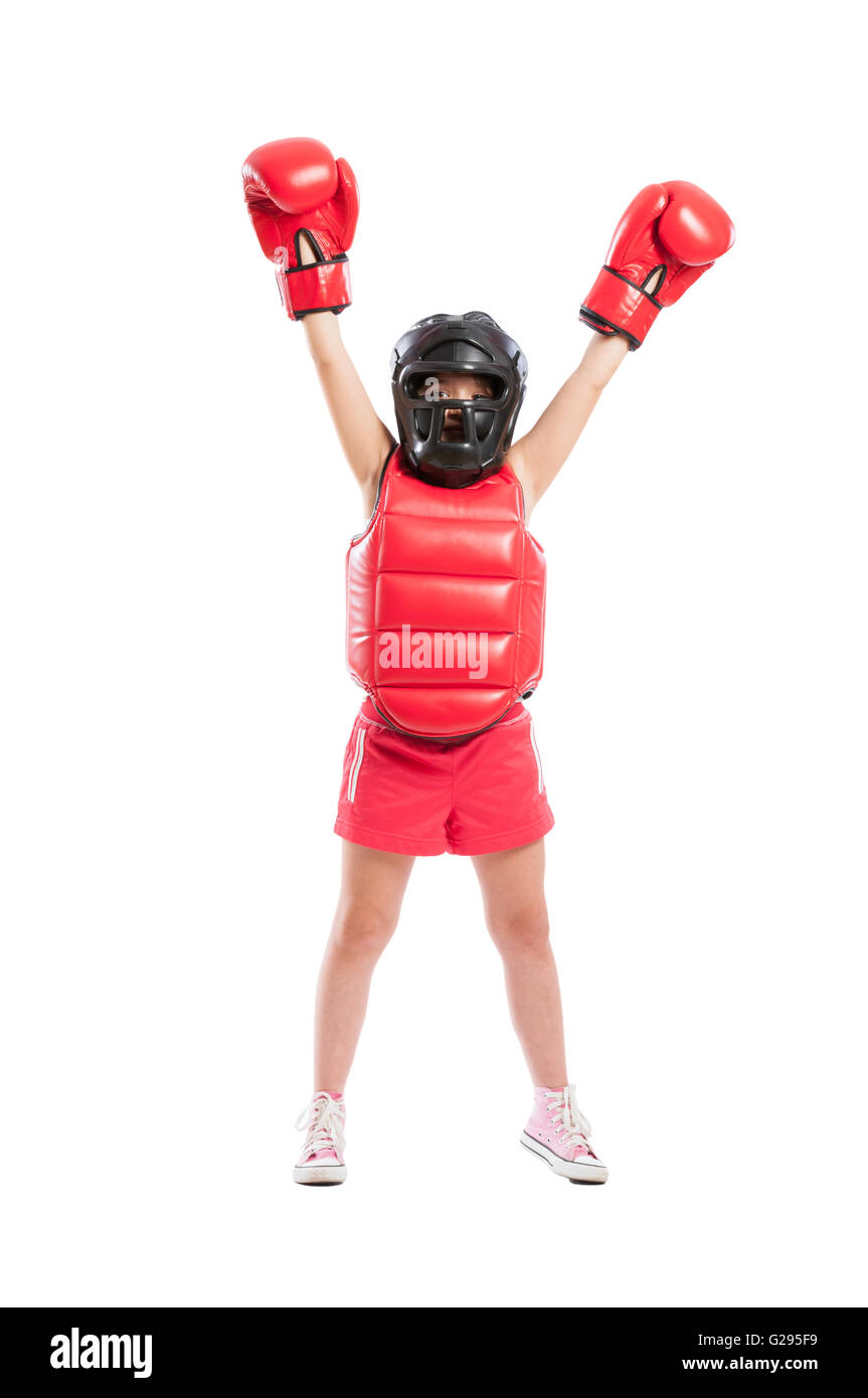 Little boxer girl acting like a champion isolated on white background - Stock Image