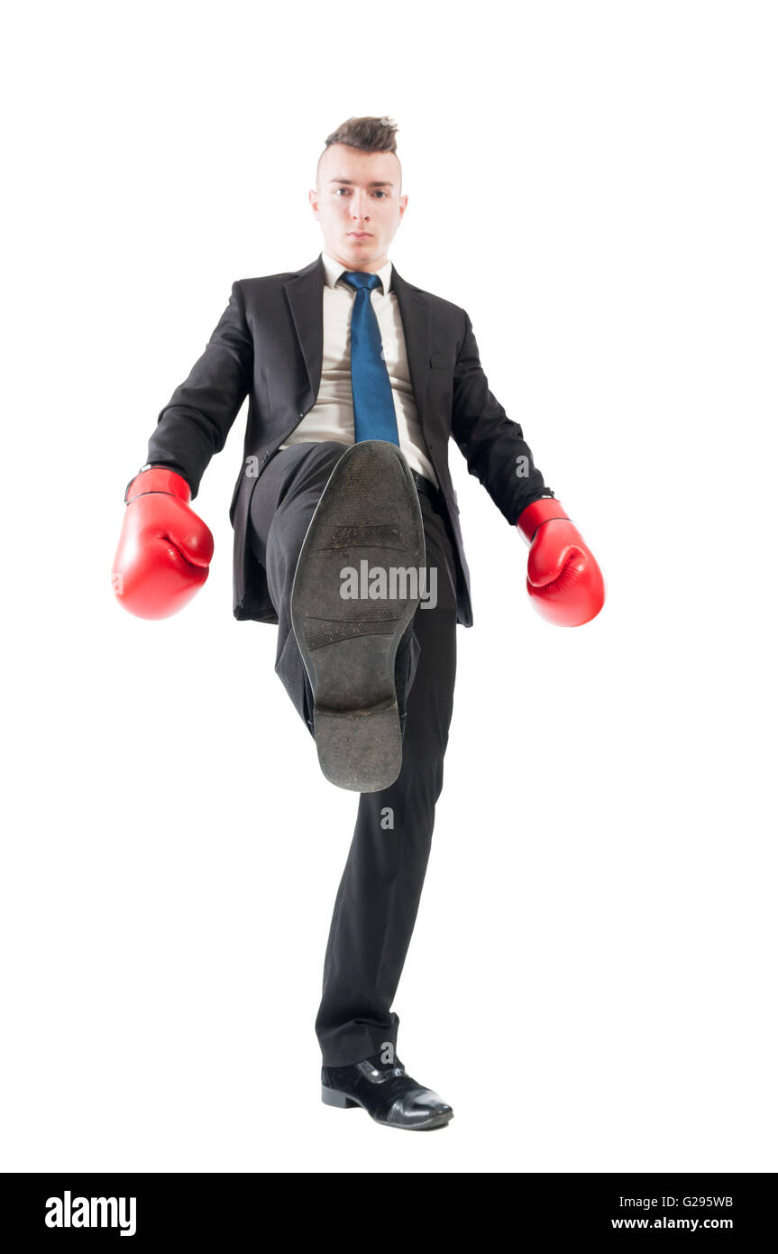 Competitive and aggresive business man tread over the competitors concept on white background - Stock Image
