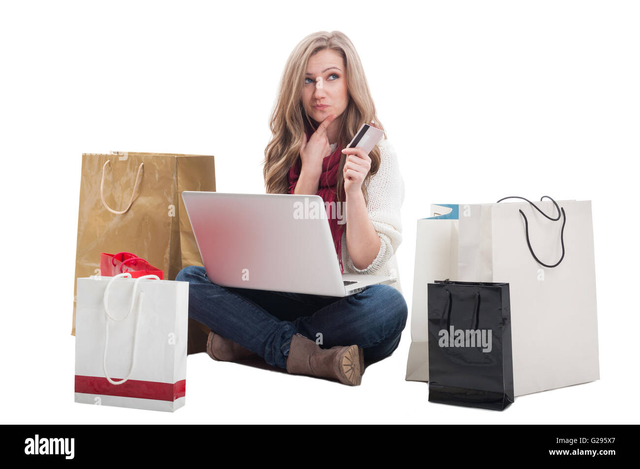 Spending money online using credit or debit card concept with a woman holding a laptop ready to spend money on e - Stock Image