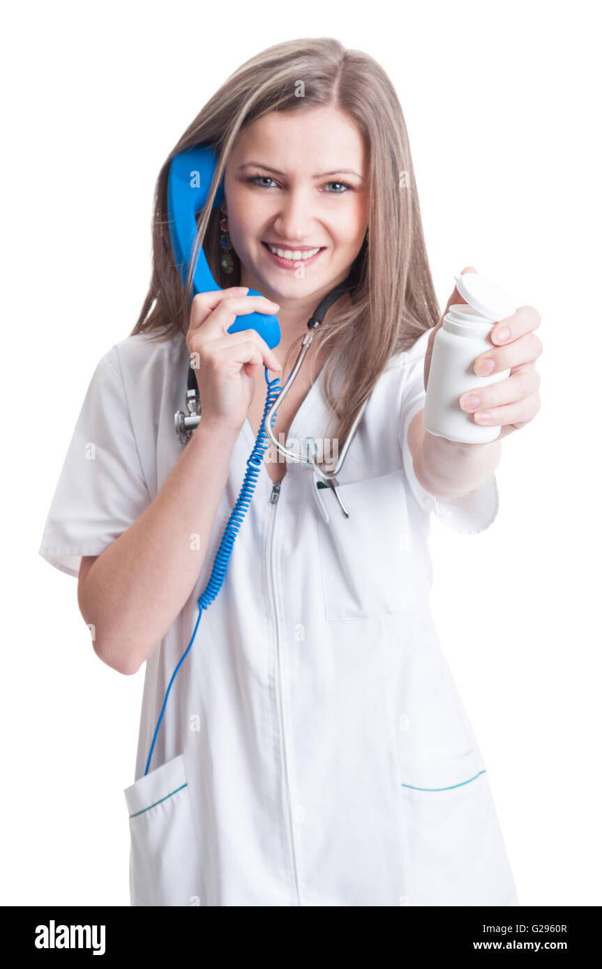 Contact hospital or clinic for refill of pills concept with female doctor holding a white recipient - Stock Image