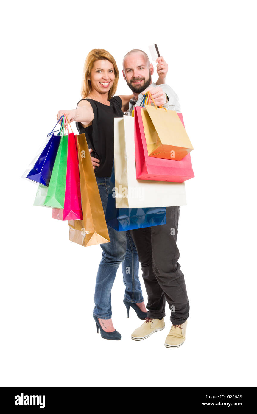 Shopping couple and credit or debit card. Consumerism relationship concept on white background - Stock Image