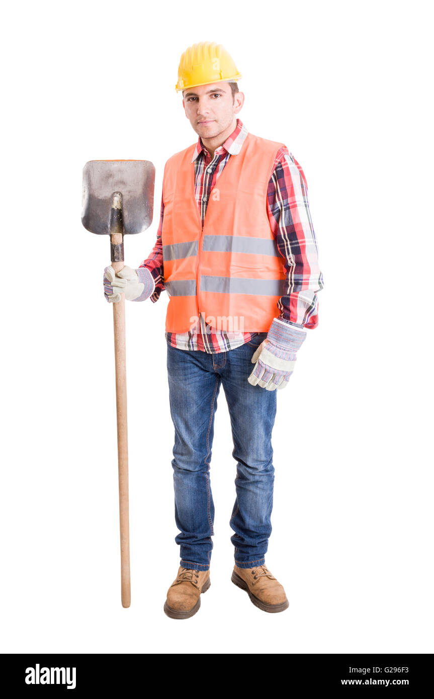 Fully equiped builder with helmet, vest, gloves and shovel - Stock Image