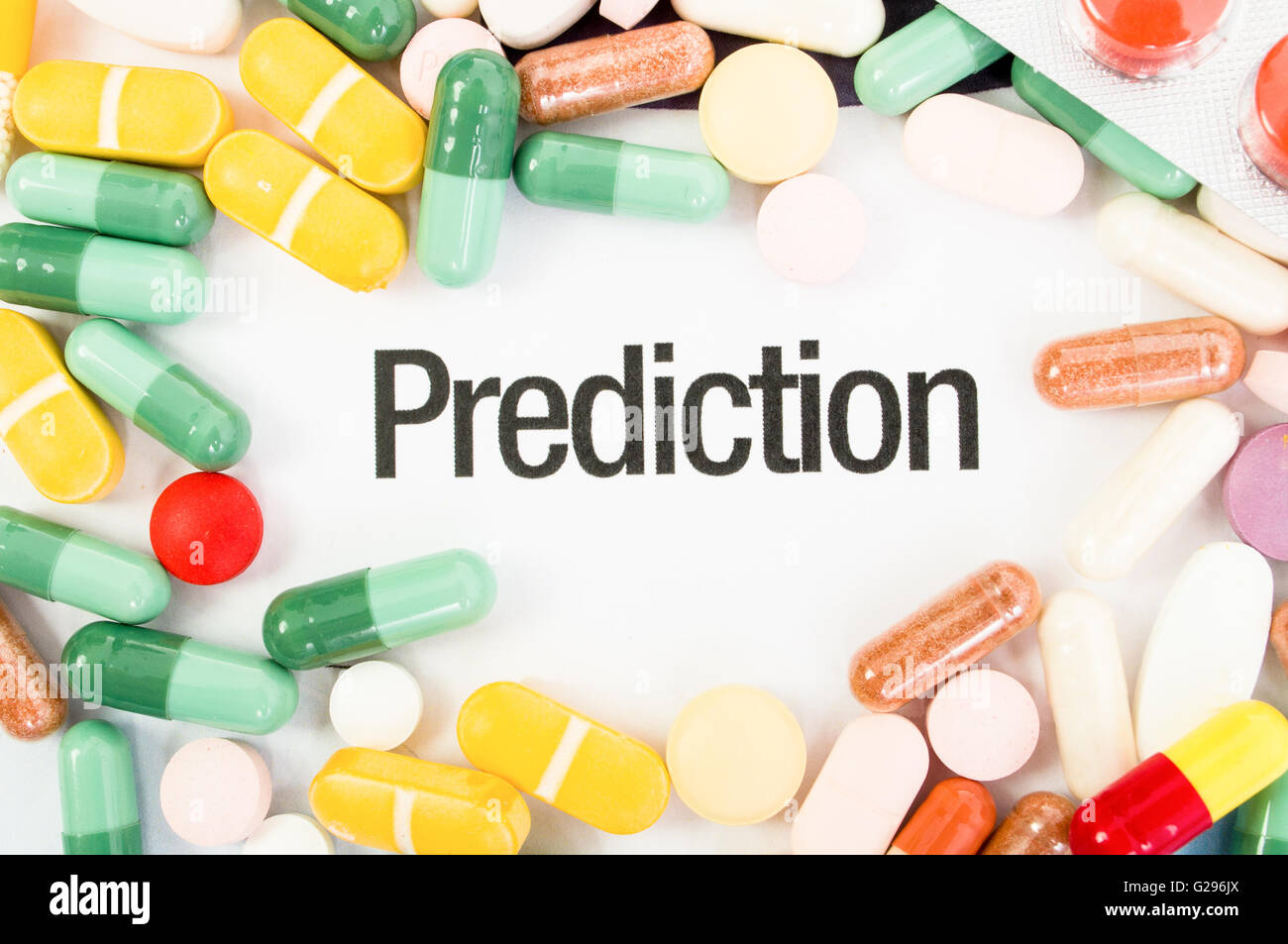 Prediction text between colored pills. Drugs sales concept - Stock Image