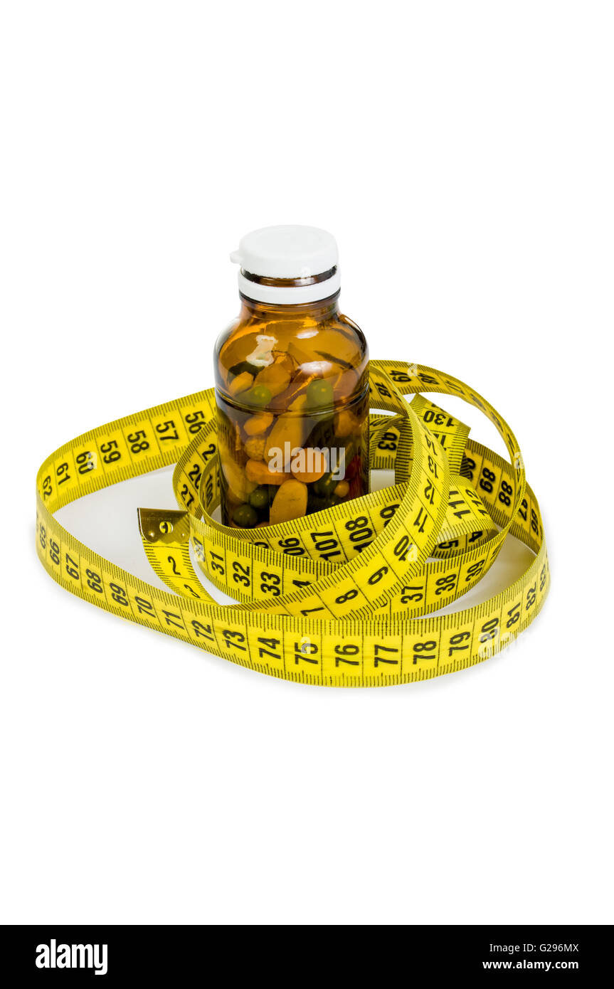 Bottle of pills and meter arround. Slim diet with pills concept Stock Photo