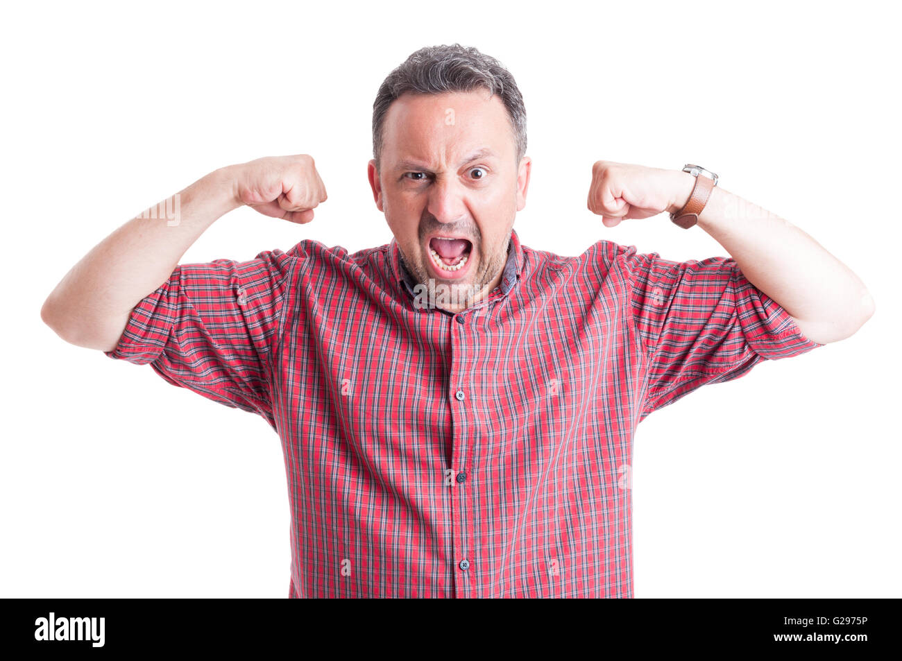 Angry, stressed and furious man shouting and flexing arms - Stock Image