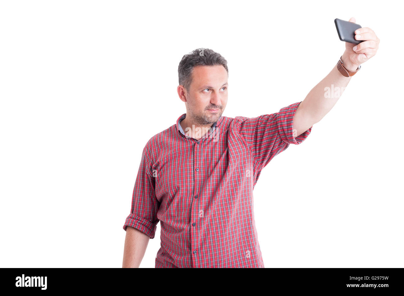 Modern man taking a selfie or selfportrait with smartphone - Stock Image