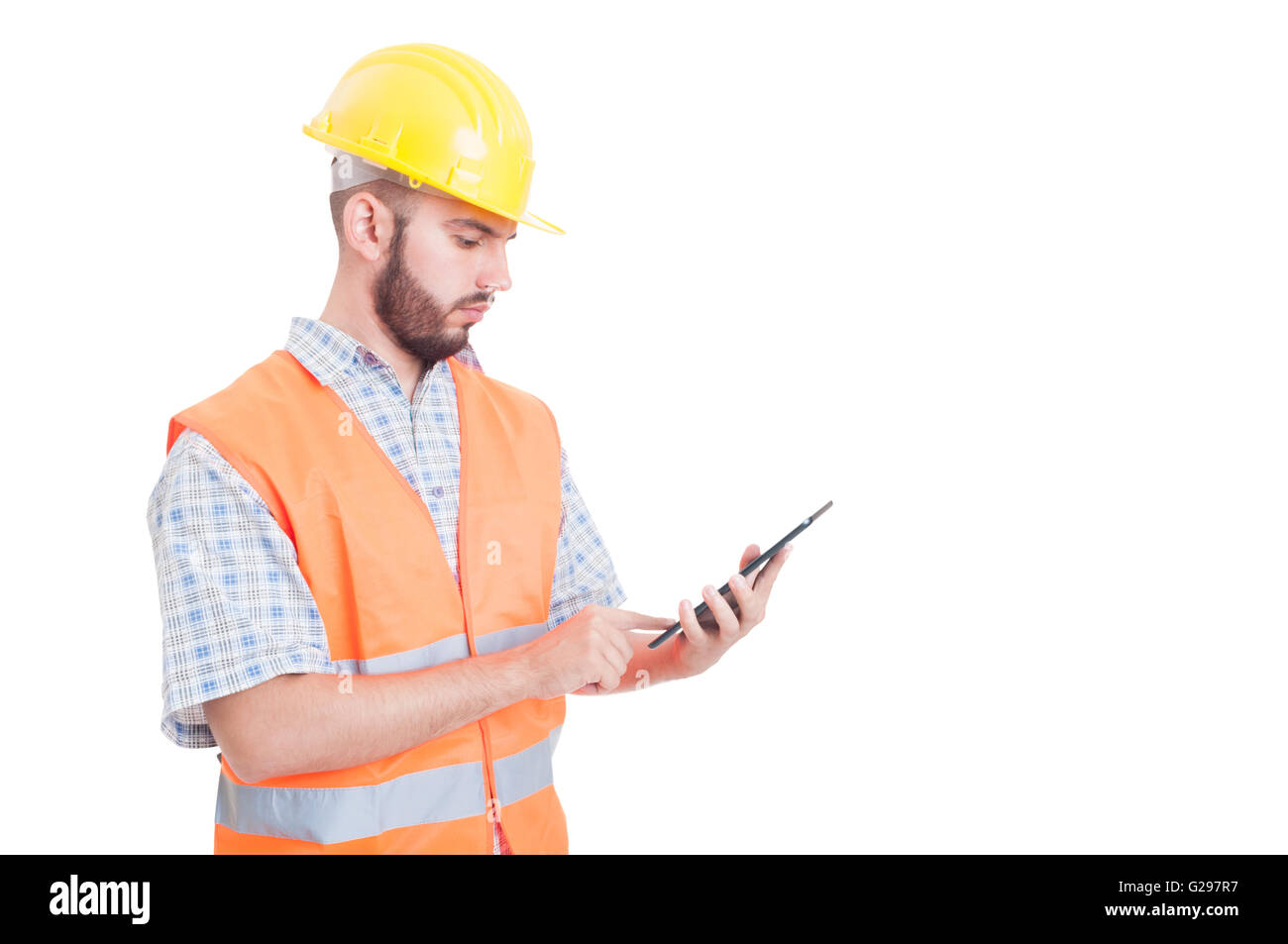 Smart and modern builder or engineer using wireless  tablet - Stock Image