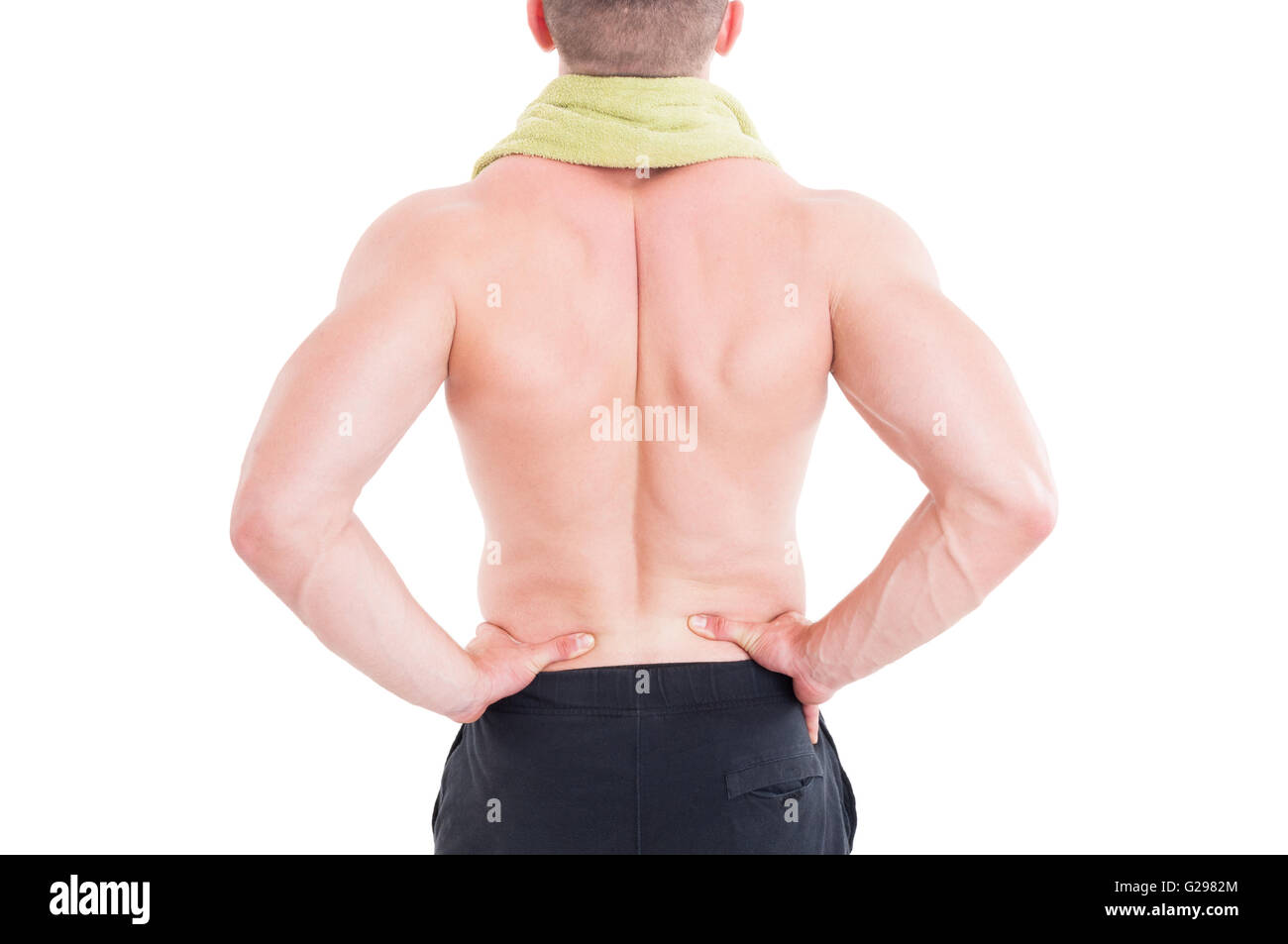 Sportive man holding his lumbar area or lower back after injury and pain - Stock Image
