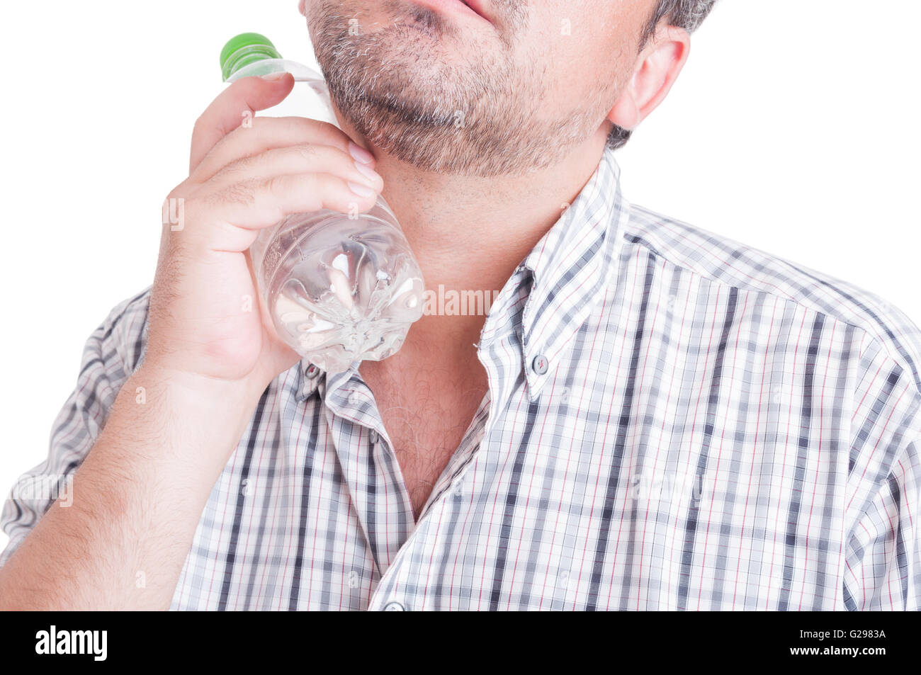 Summer heat or heatwave concept with man holding a bottle of cold water isolated on white - Stock Image
