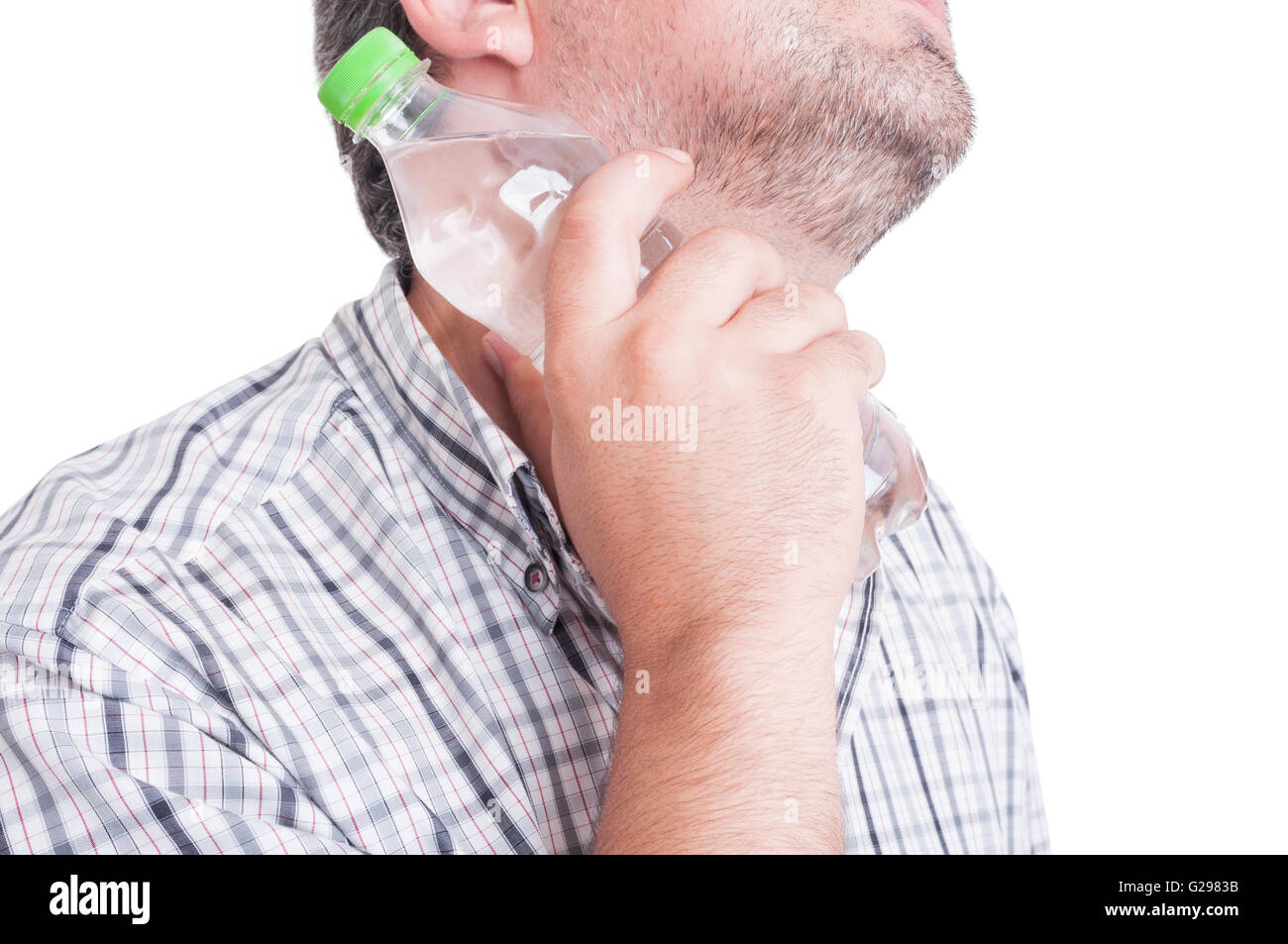 Man cooling his neck with a bottle of cold water as summer heat or heatwave concept - Stock Image