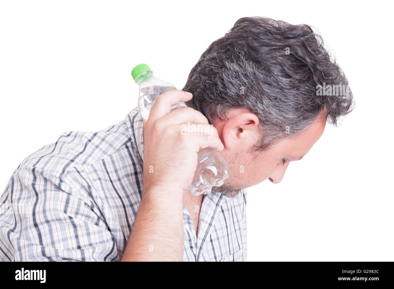 Man cooling down with a bottle of cold water as summer heat or heatwave concept - Stock Image
