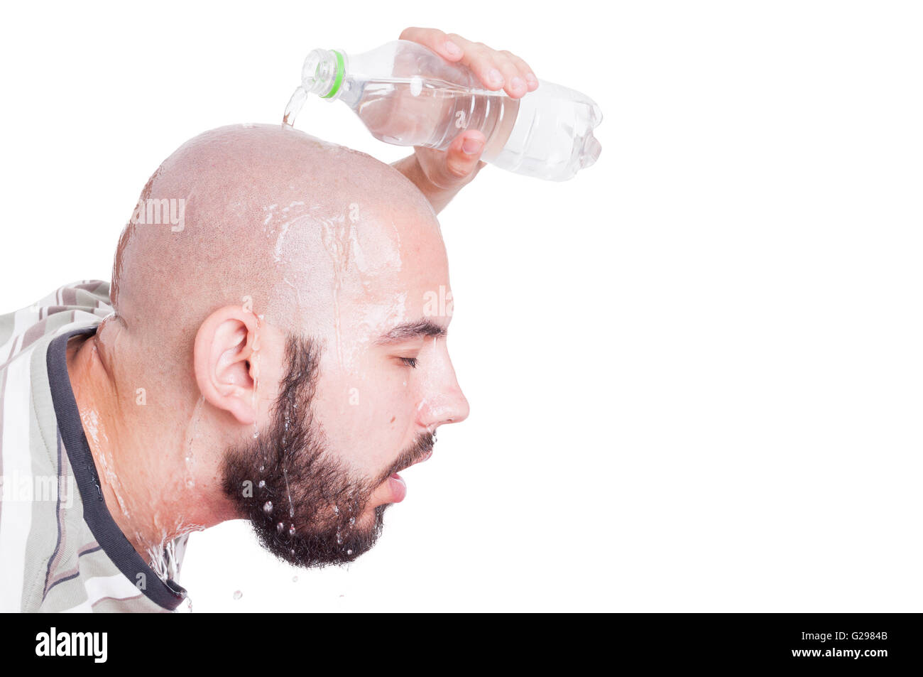 man refreshing or cooling his head with cold water in summer heat concept isolated on white - Stock Image