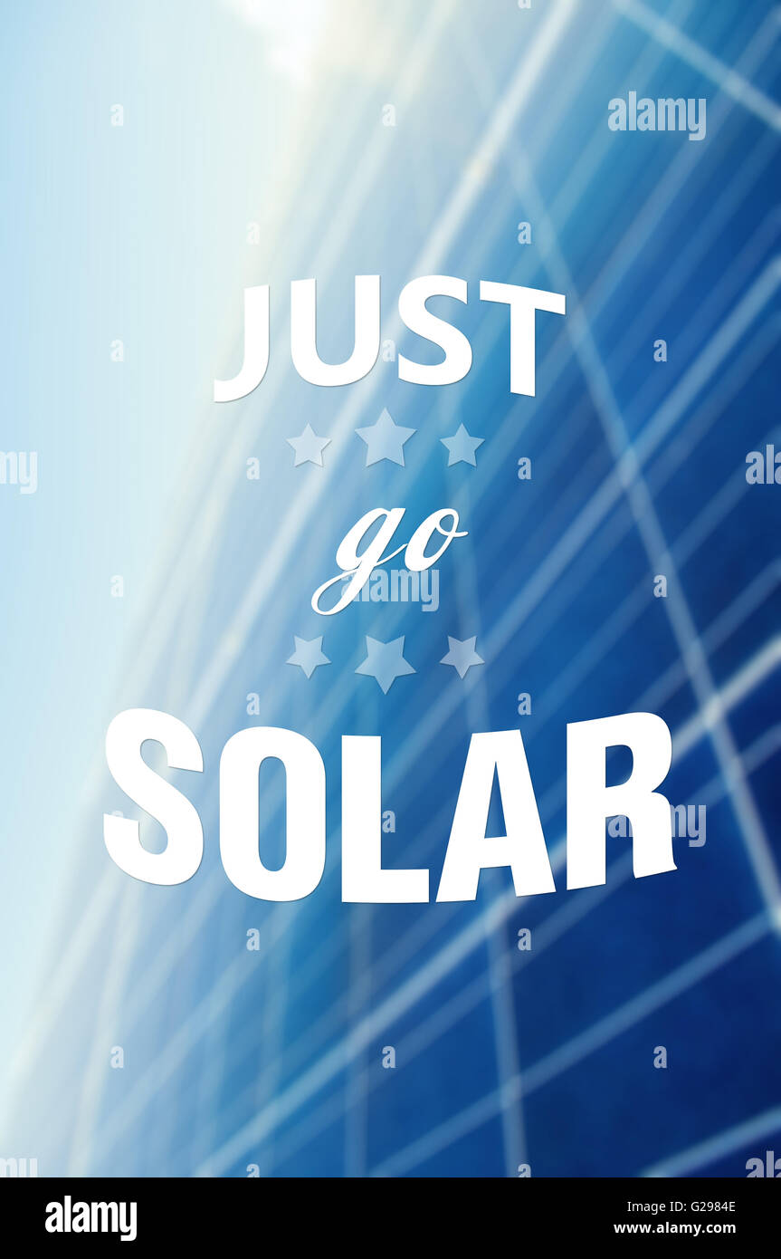 Just go solar quote or text on solarpower panel background as green energy concept illustration - Stock Image