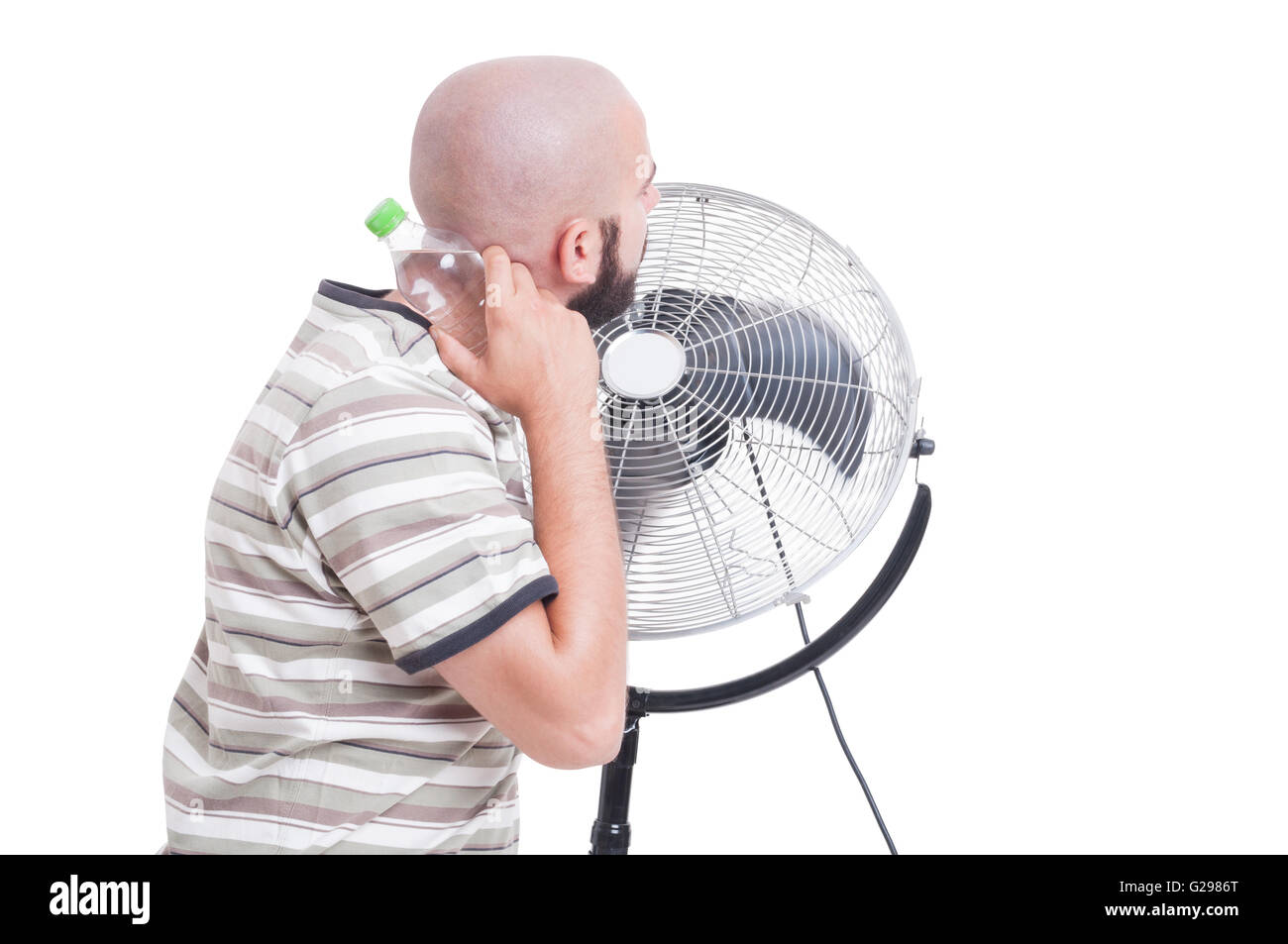 Man cooling down with blowing fan and cold water isolated on white Stock Photo