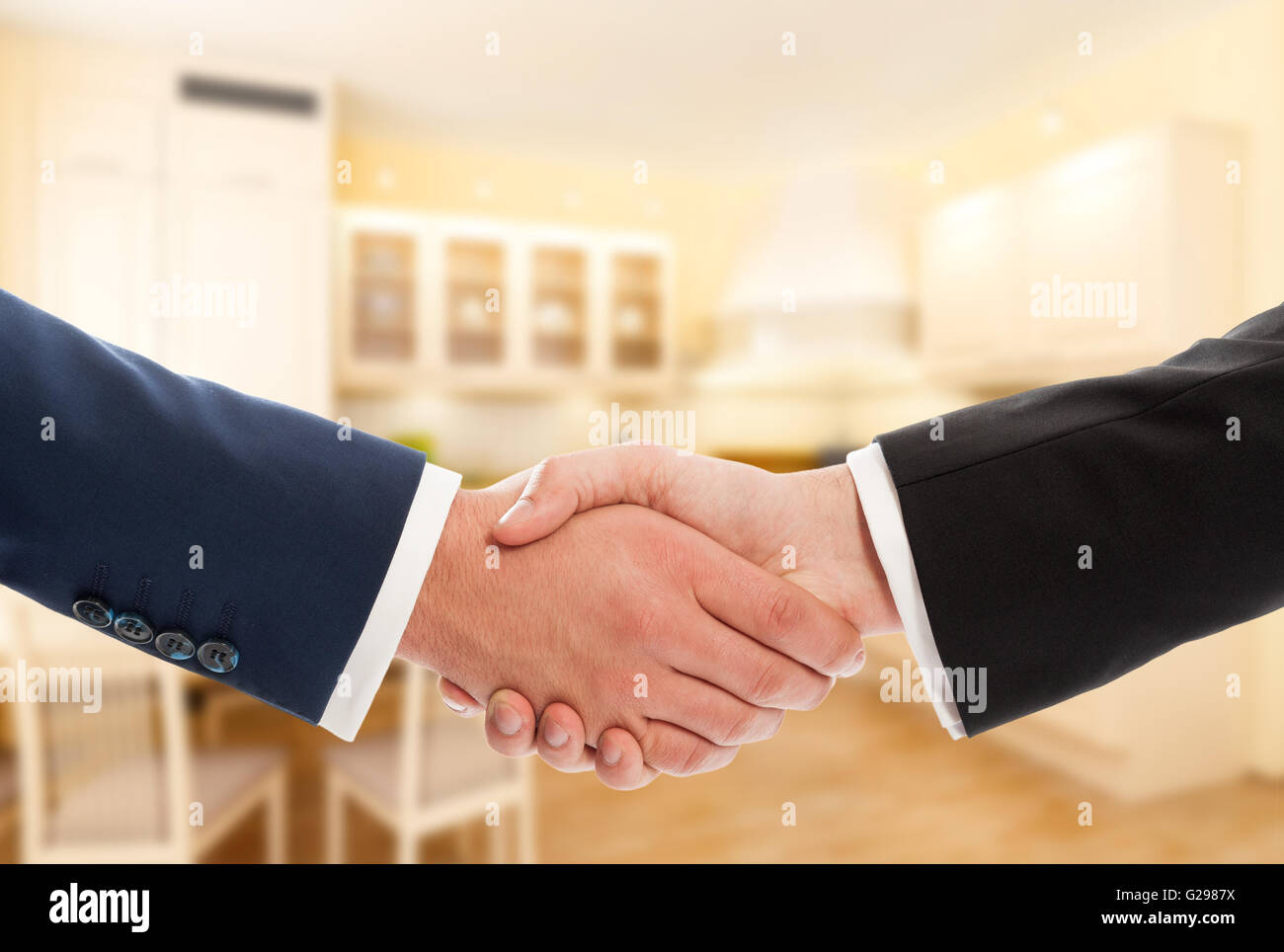 Buy or sale real estate concept with businessmen handshake. Realtor and client or buyer and seller - Stock Image