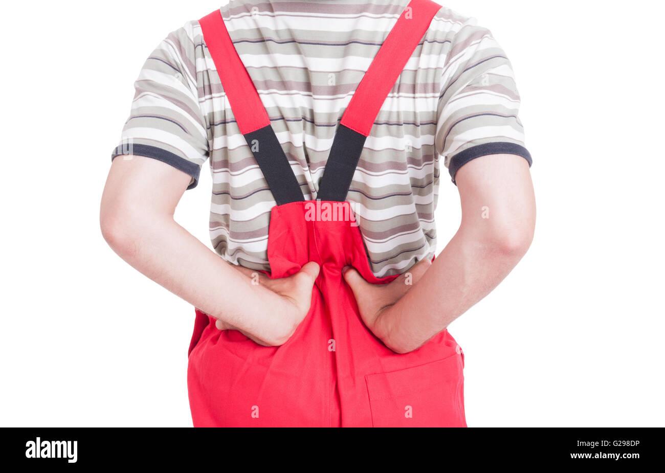 Mechanic or plumber having lumbar area pain or lower back medical problem - Stock Image