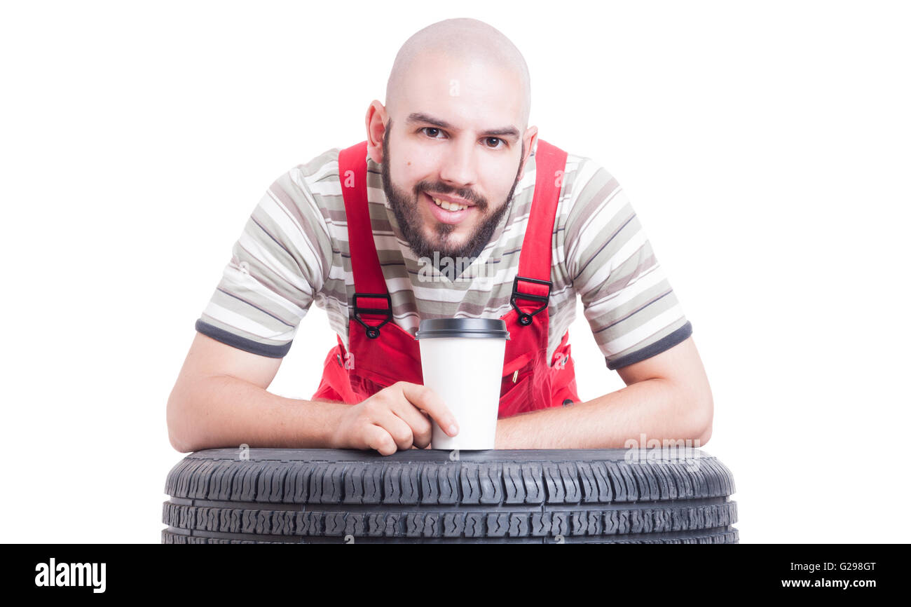Mechanic taking a coffee break after work concept isolated on white - Stock Image