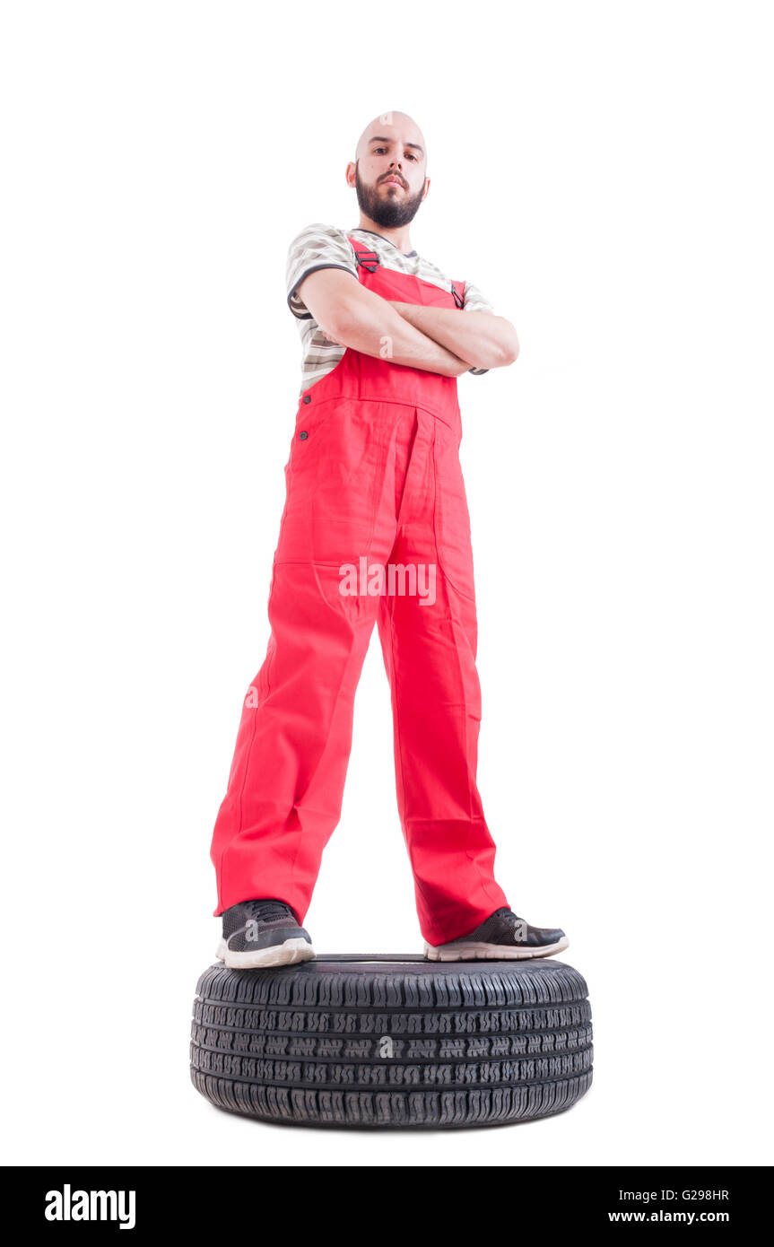 Hero shot low angle of proud and confident mechanic isolated on white - Stock Image