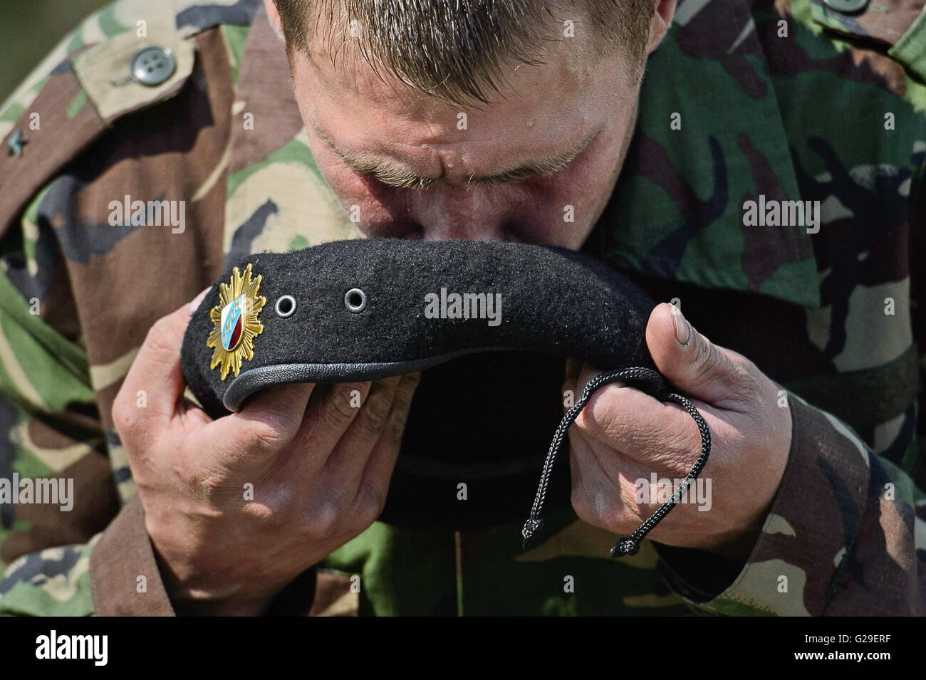 YEKATERINBURG, RUSSIA – MAY 26, 2016: An OMON special police officer holds an earned black beret after passing a - Stock Image