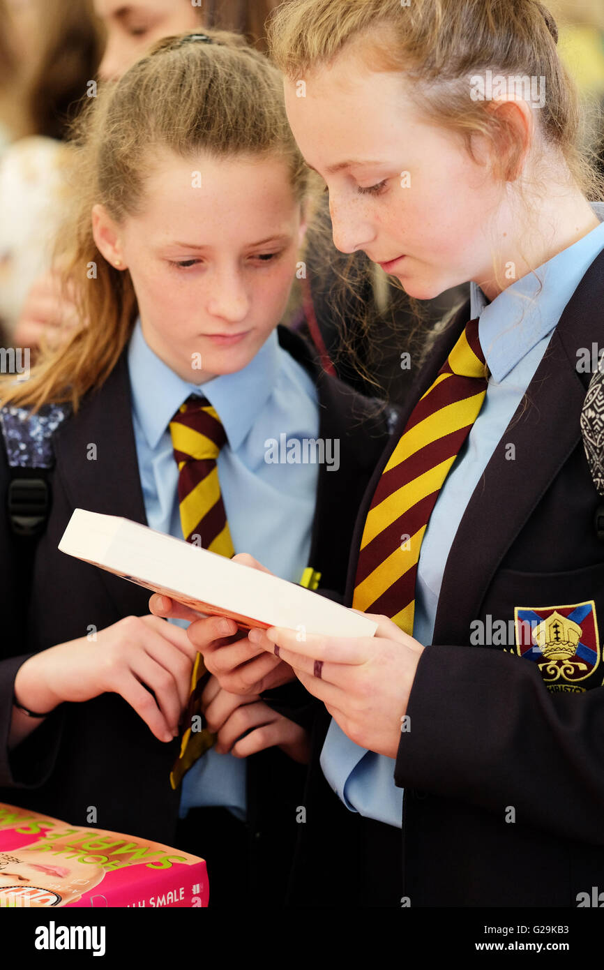 Hay on Wye, Wales, UK - May, 2016. A school pupil browses the books on sale in the Festival bookshop. The second - Stock Image