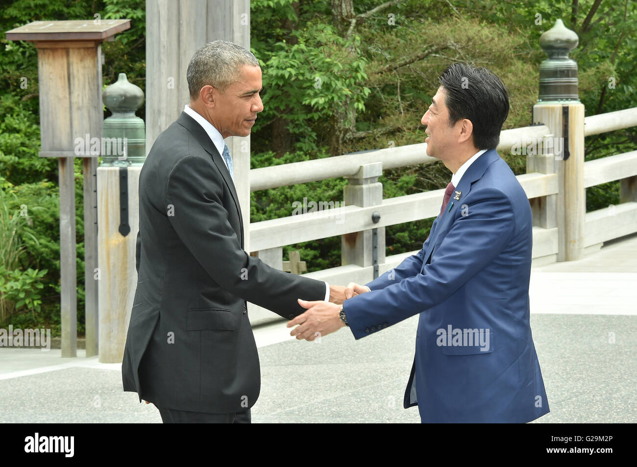 Us president barack obama is greeting by japanese prime minister us president barack obama is greeting by japanese prime minister shinzo abe at the start of the g7 summit at the ise jingu shrine may 26 2016 in ise m4hsunfo