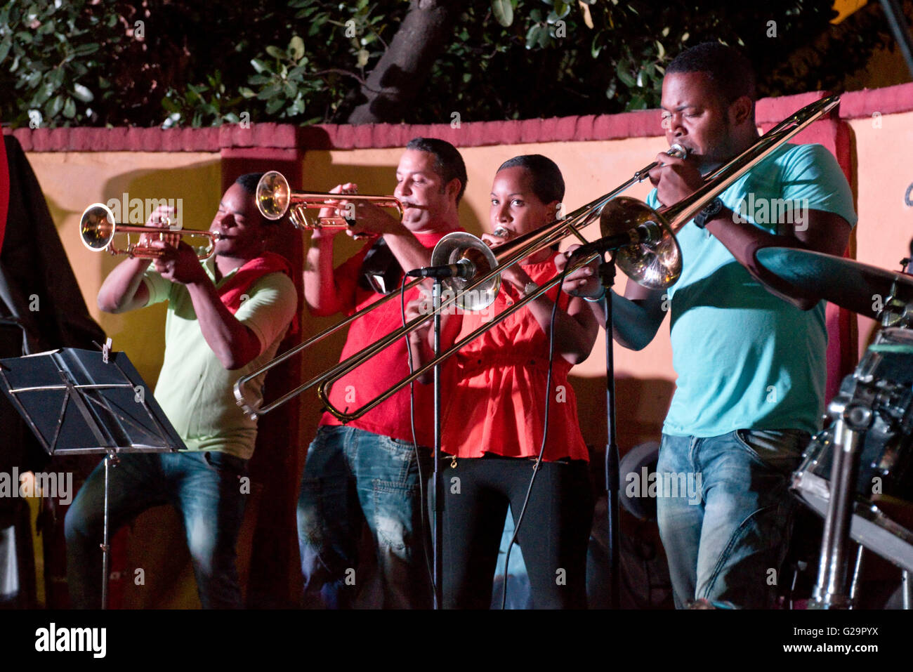 Cuban musicians playing salsa music for locals and tourists at the