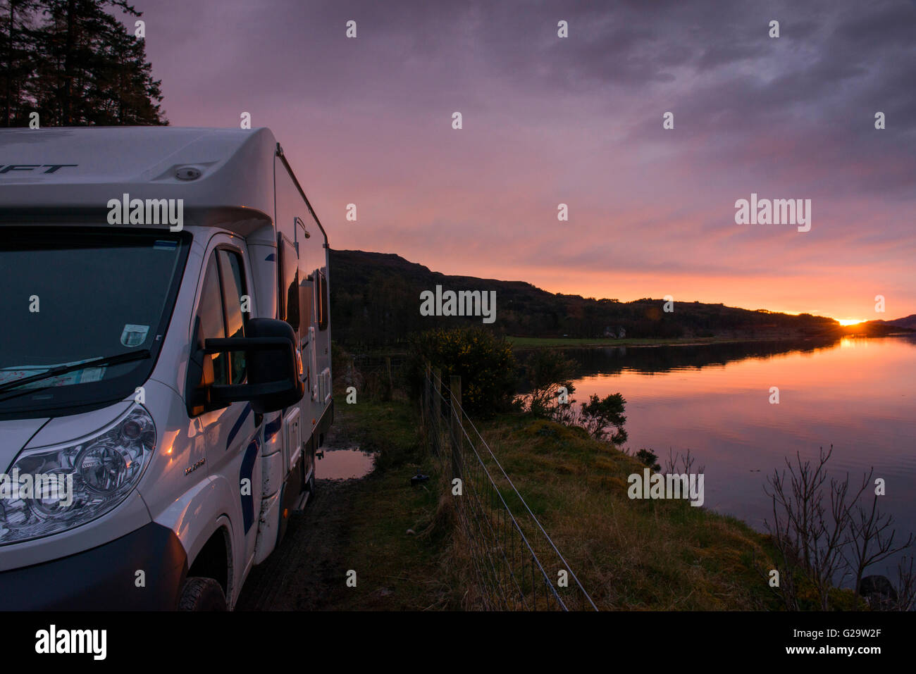 Motorhome parked up in a parking place as the sun sets by Loch Torridon, at Torridon Village in Scotland UK - Stock Image