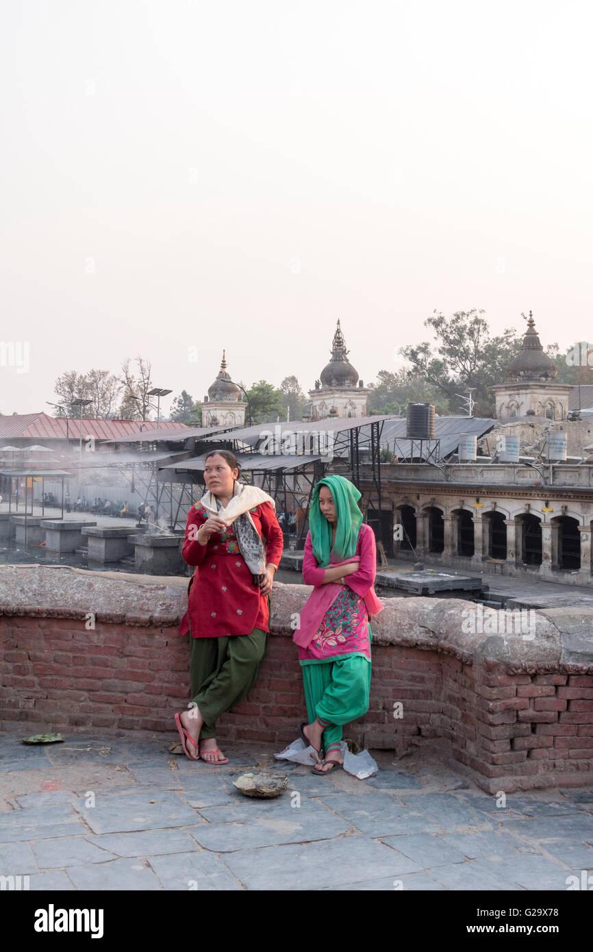 Local women at Pashupatinath Temple, a sacred Hindu Temple, Kathmandu, Nepal - Stock Image