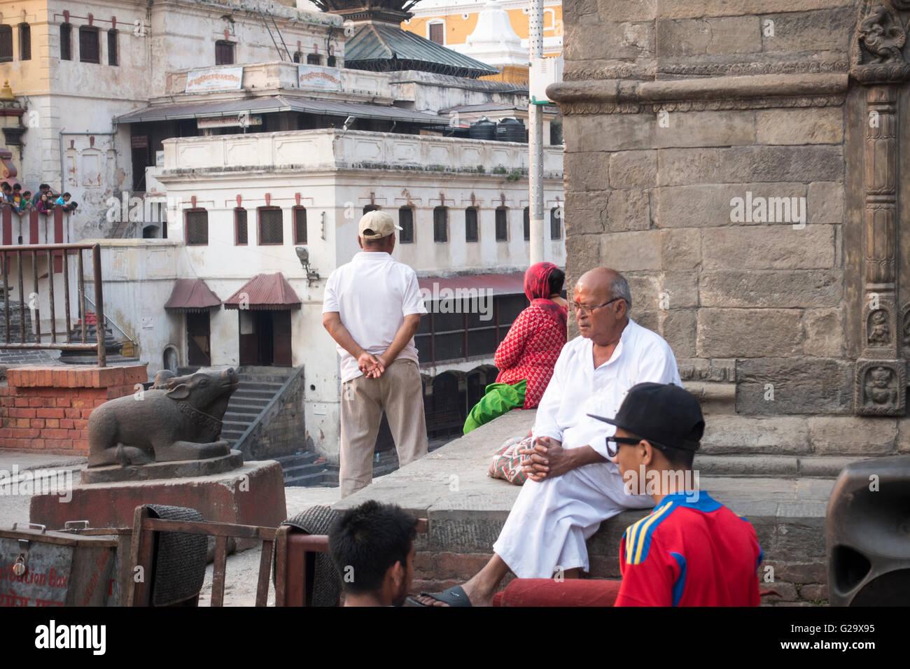 People outdoors at Pashupatinath Temple, sacred Hindu Temple, Kathmandu, Nepal - Stock Image
