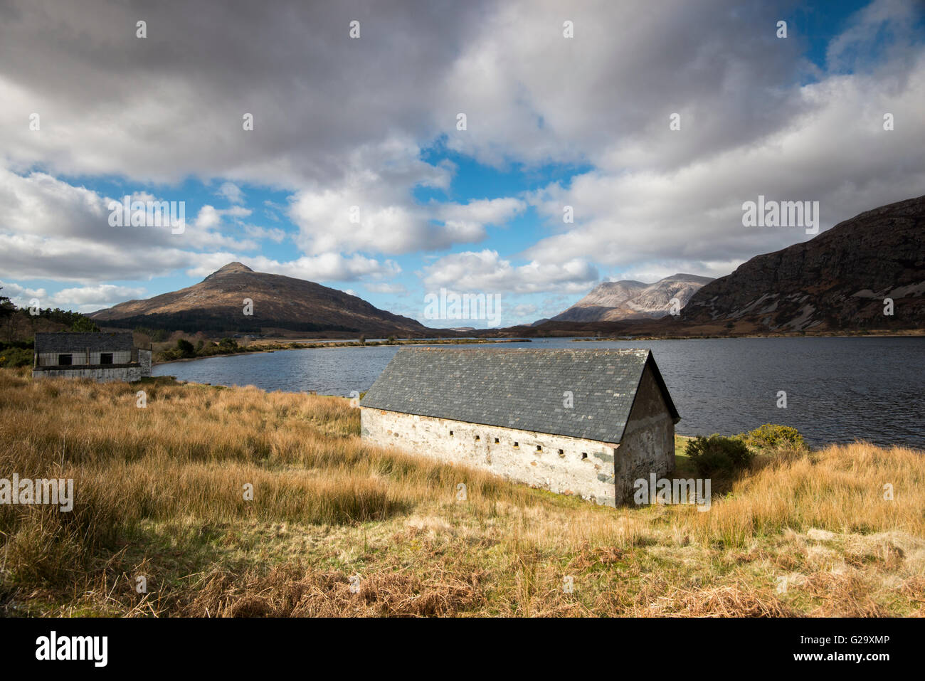 Lone Cottage by the side of Loch More in Sutherland Scotland UK - Stock Image