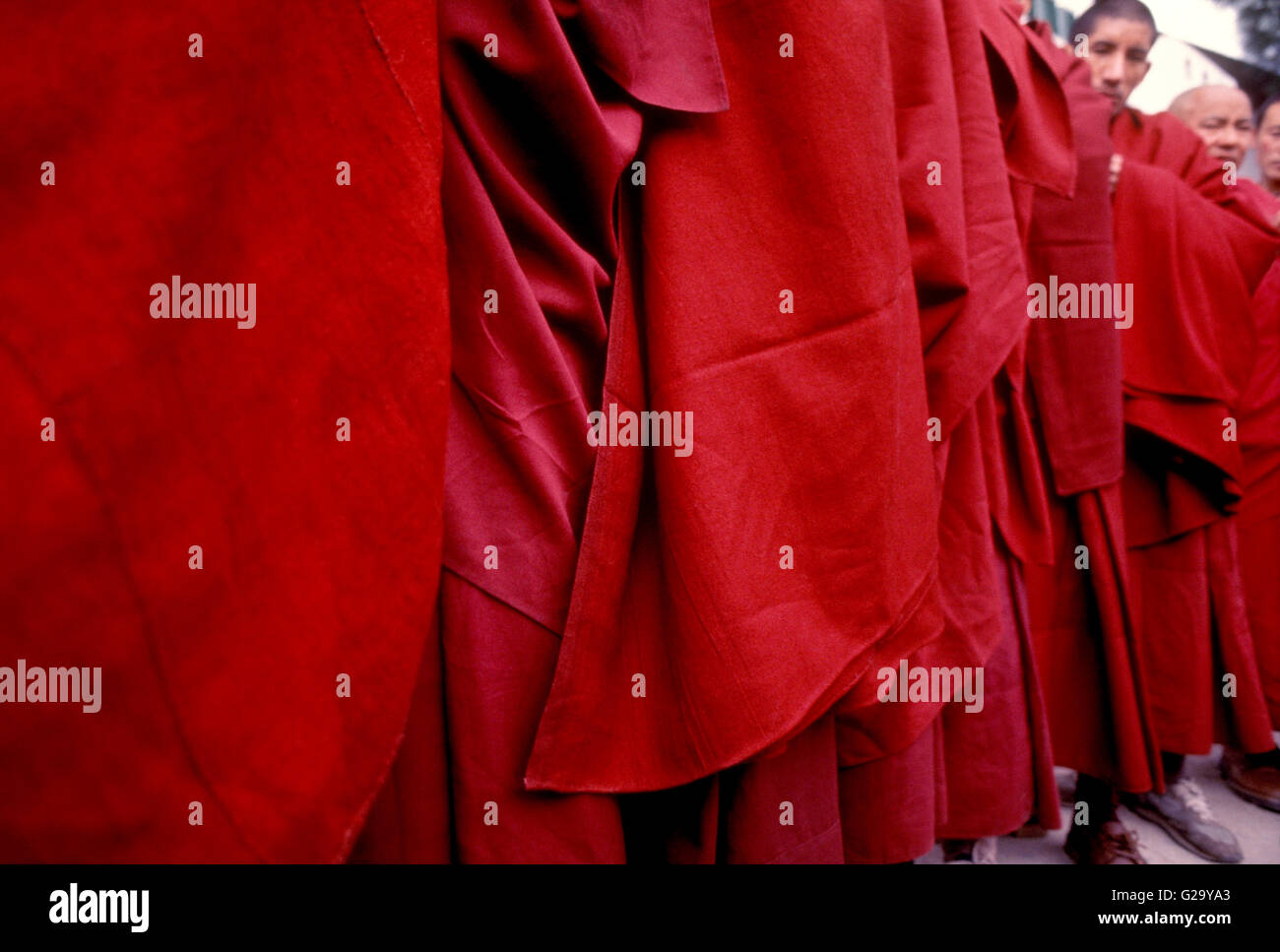 Tibetan monks stand in line to be blessed by the Dalai Lama in front of his home in Mcleod Ganj, India. - Stock Image