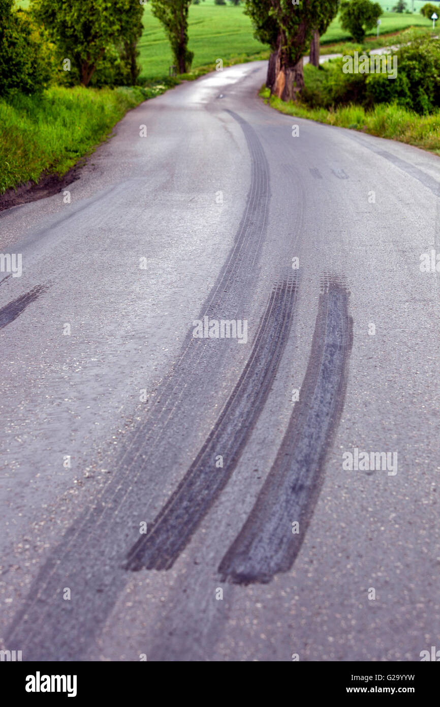 Braking distance tire on a country road - Stock Image
