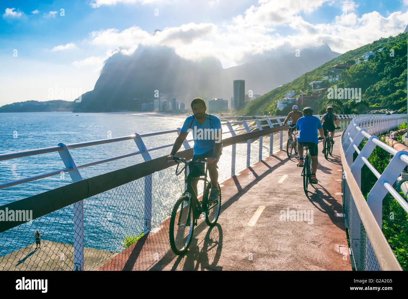RIO DE JANEIRO - MARCH 19, 2016: Cyclists ride along the newly completed Ciclovia Tim Maia bike path, an Olympic - Stock Image