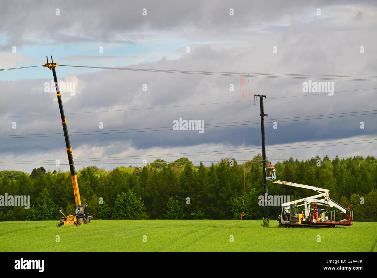 engineers constructing new power line pylons and cable leeds yorkshire united kingdom - Stock Image