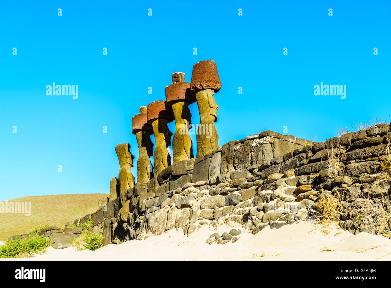 Moai at Ahu Nau Nau in Anakena Beach on Easter Island, Chile - Stock Image