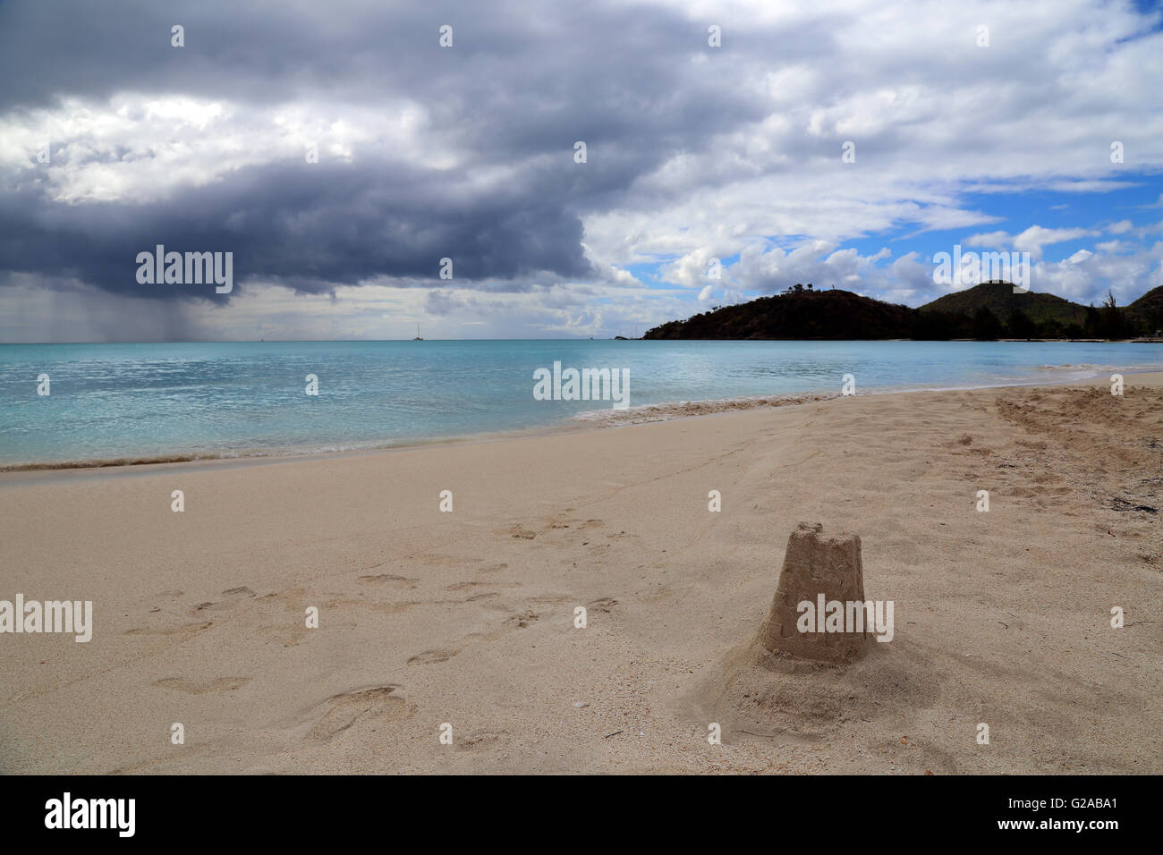 Storm clouds and rain on the horizon, Jolly Bay beach, Antigua, Caribbean - Stock Image
