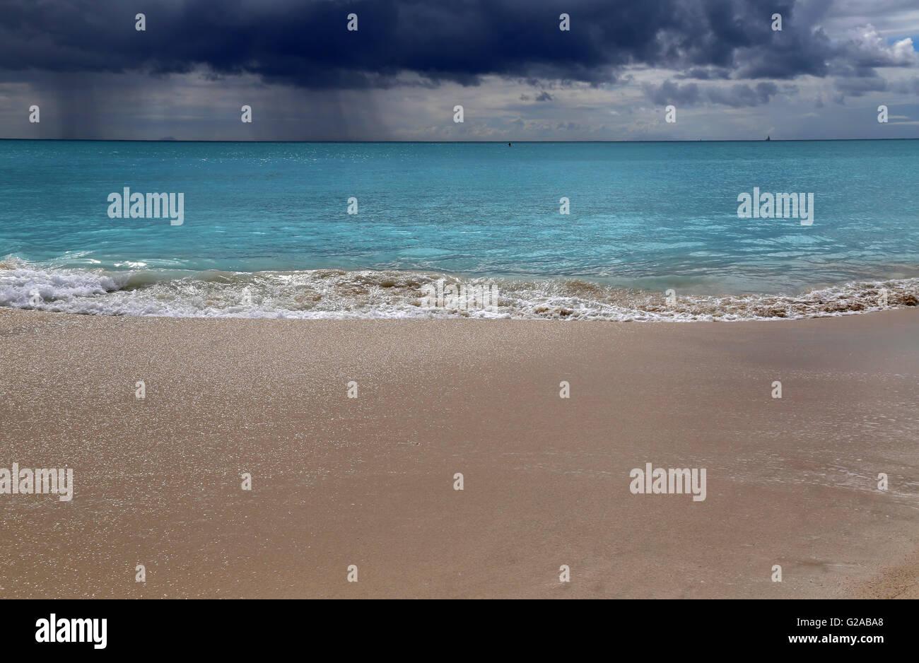 Storm clouds and rain on the horizon, Jolly Bay beach, Antigua, Caribbean - Stock Image
