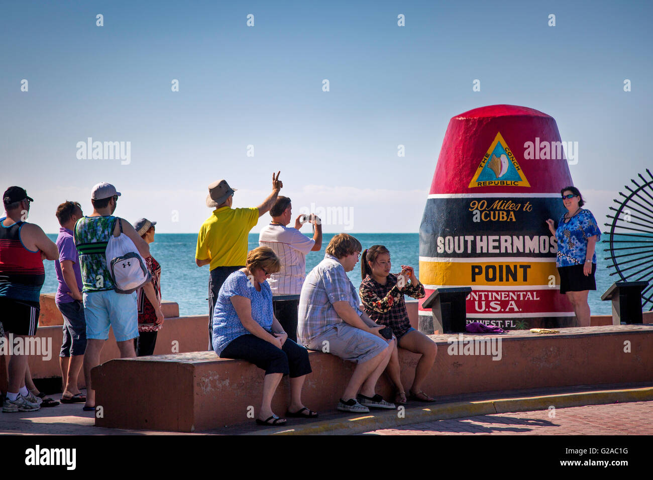 Tourists photographing themselves at the Marker at the Southernmost Point in America, Key West, Florida, USA - Stock Image