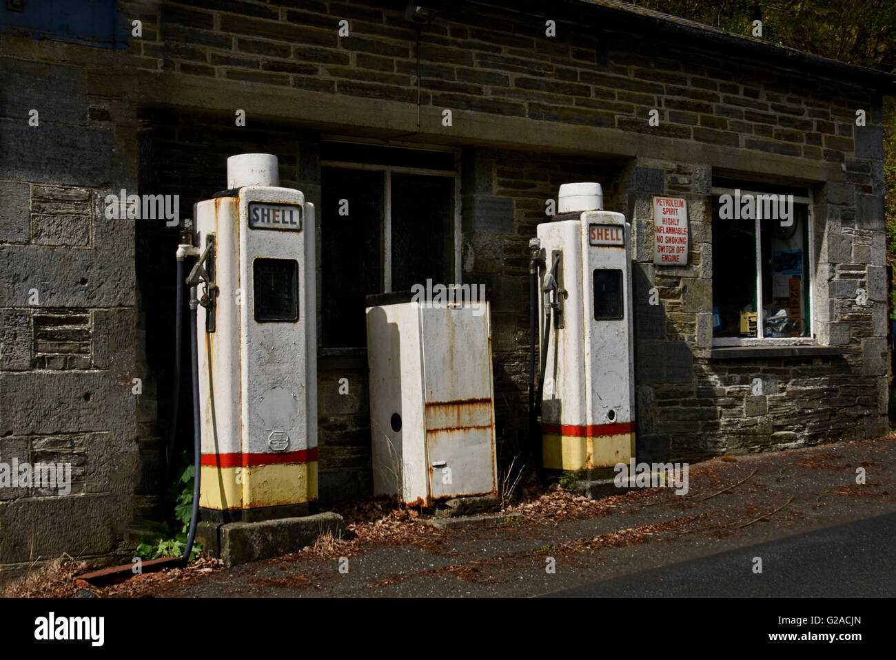 Abandoned and unused old petrol pumps. - Stock Image