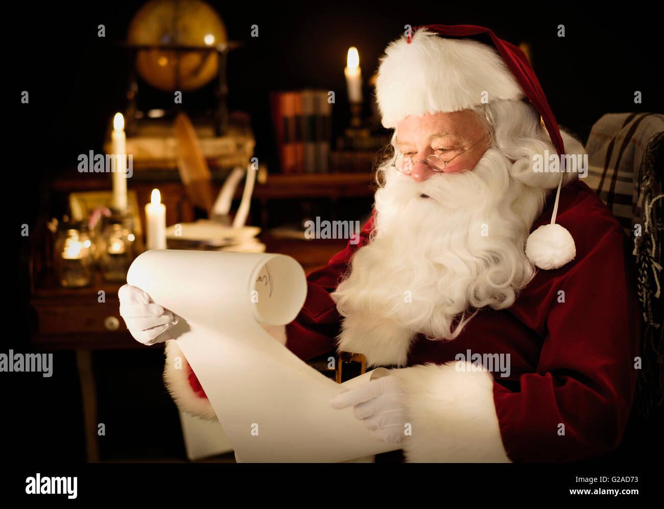 Portrait of Santa Claus reading child's letter - Stock Image