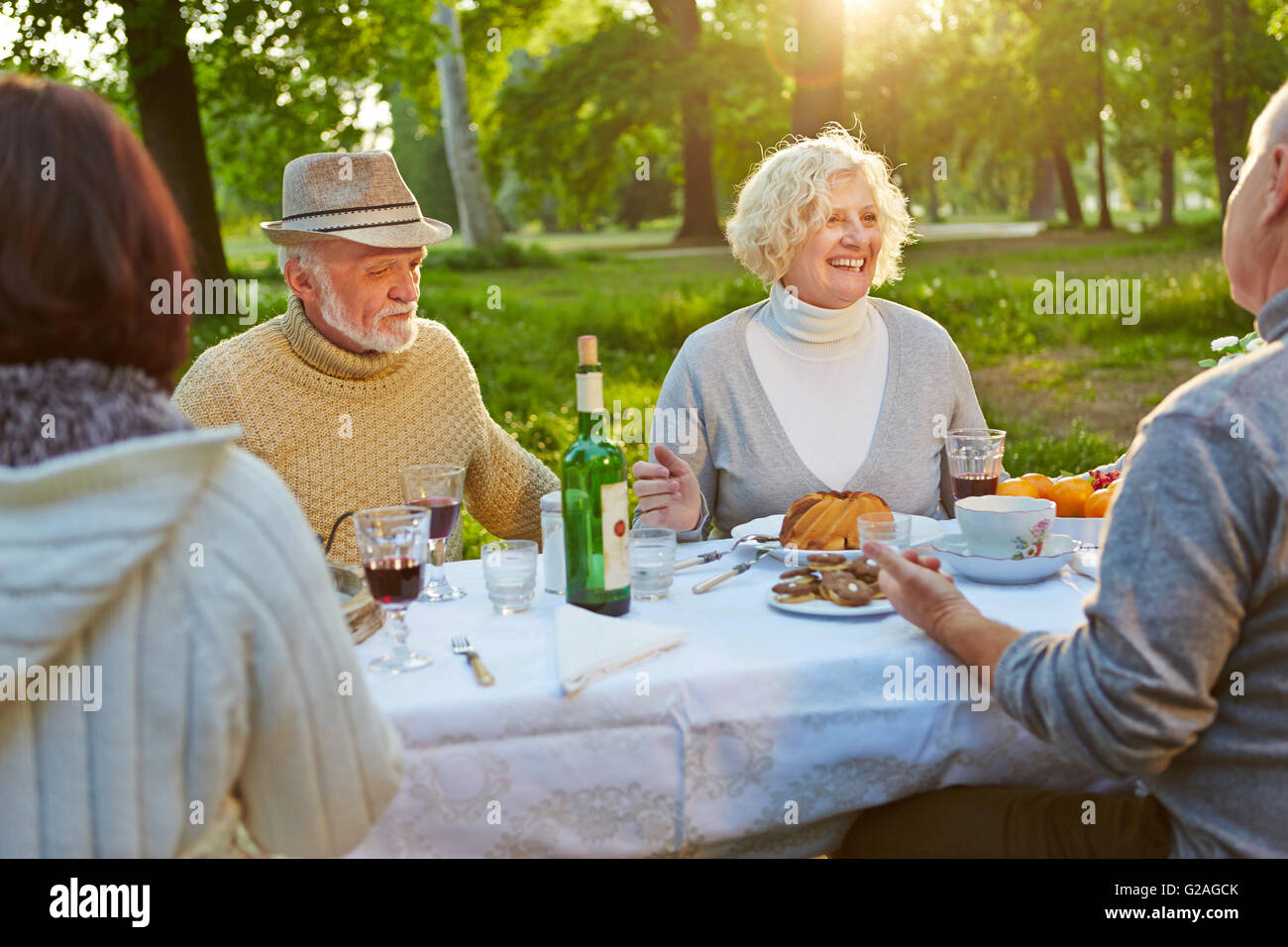 Happy family with seniors celebrating birthday in a garden in summer Stock Photo