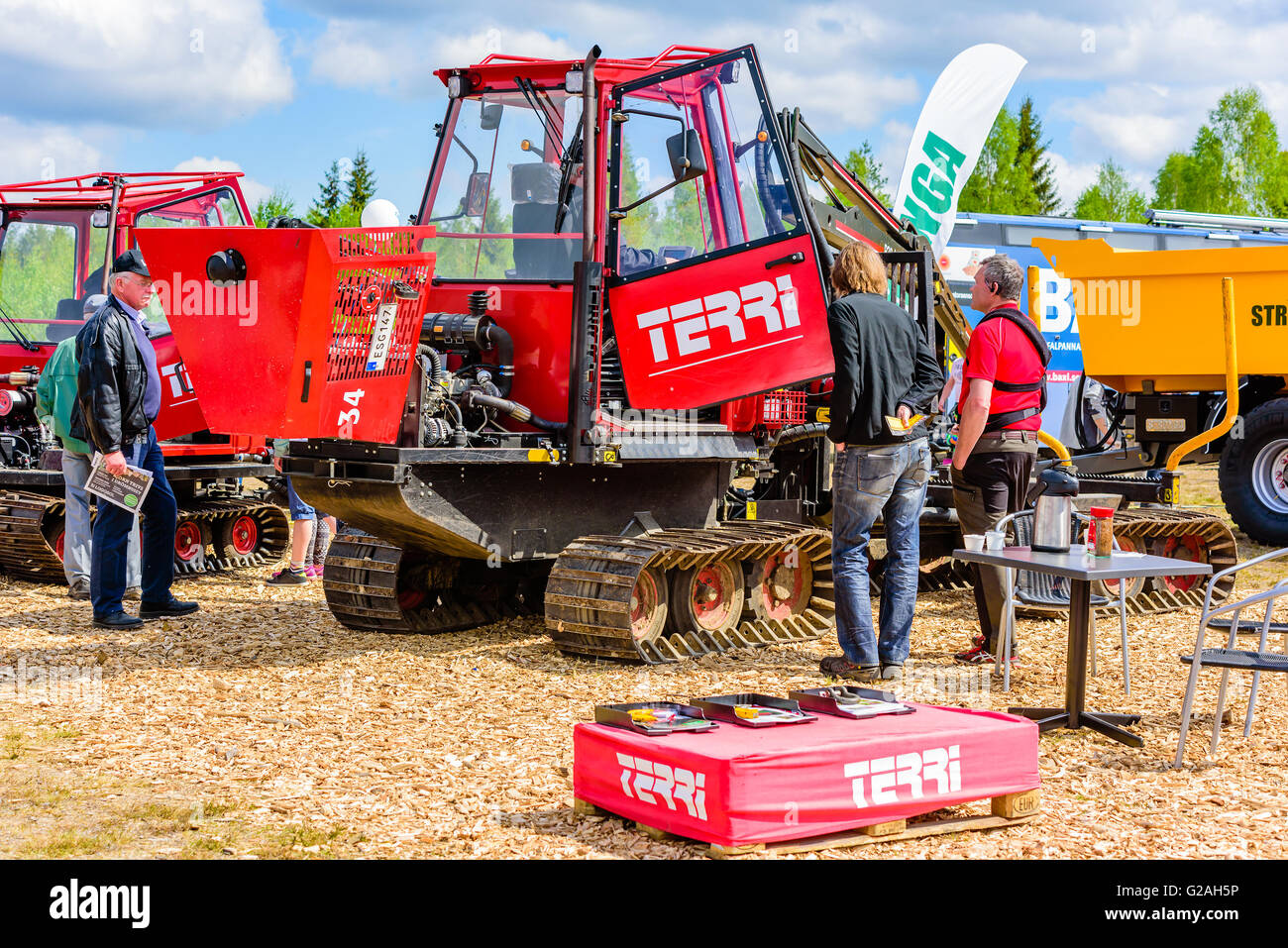 Emmaboda, Sweden - May 14, 2016: Forest and tractor (Skog och traktor) fair. People looking closer at the Terri Stock Photo