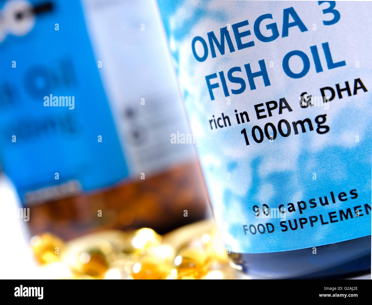 Omega 3 fish oil protein eich in EPA & DHA 1000mg capsules in a studio setting - Stock Image