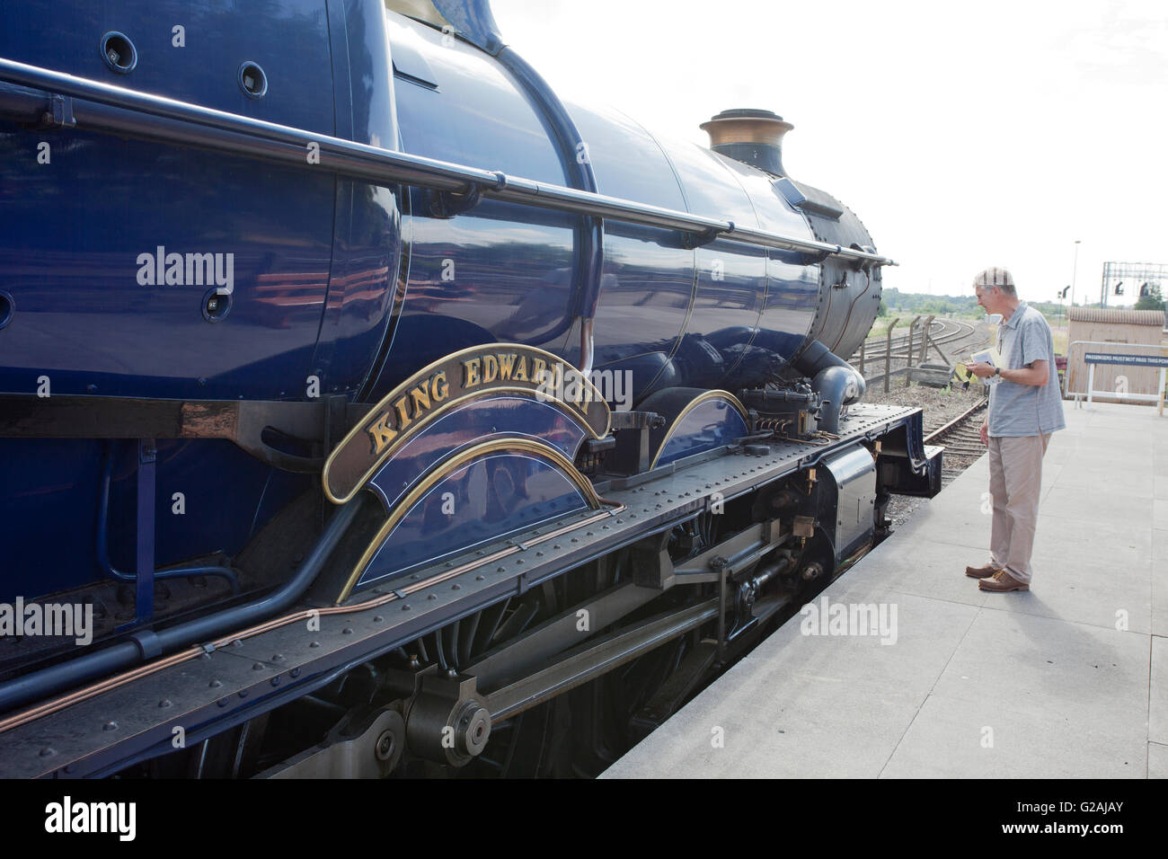 A visitor examining former GWR loco 6023 'King Edward II' preserved at the Didcot Railway Centre, Oxfordshire, - Stock Image