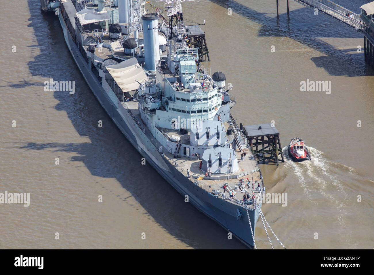 An aerial view of HMS Belfast a former Royal Navy light cruiser and now a London tourist attraction - Stock Image