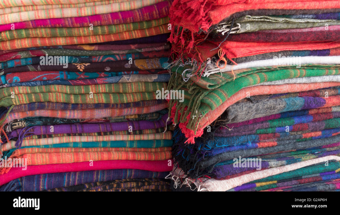 Stack of yak wool blankets for sale in Nepal - Stock Image