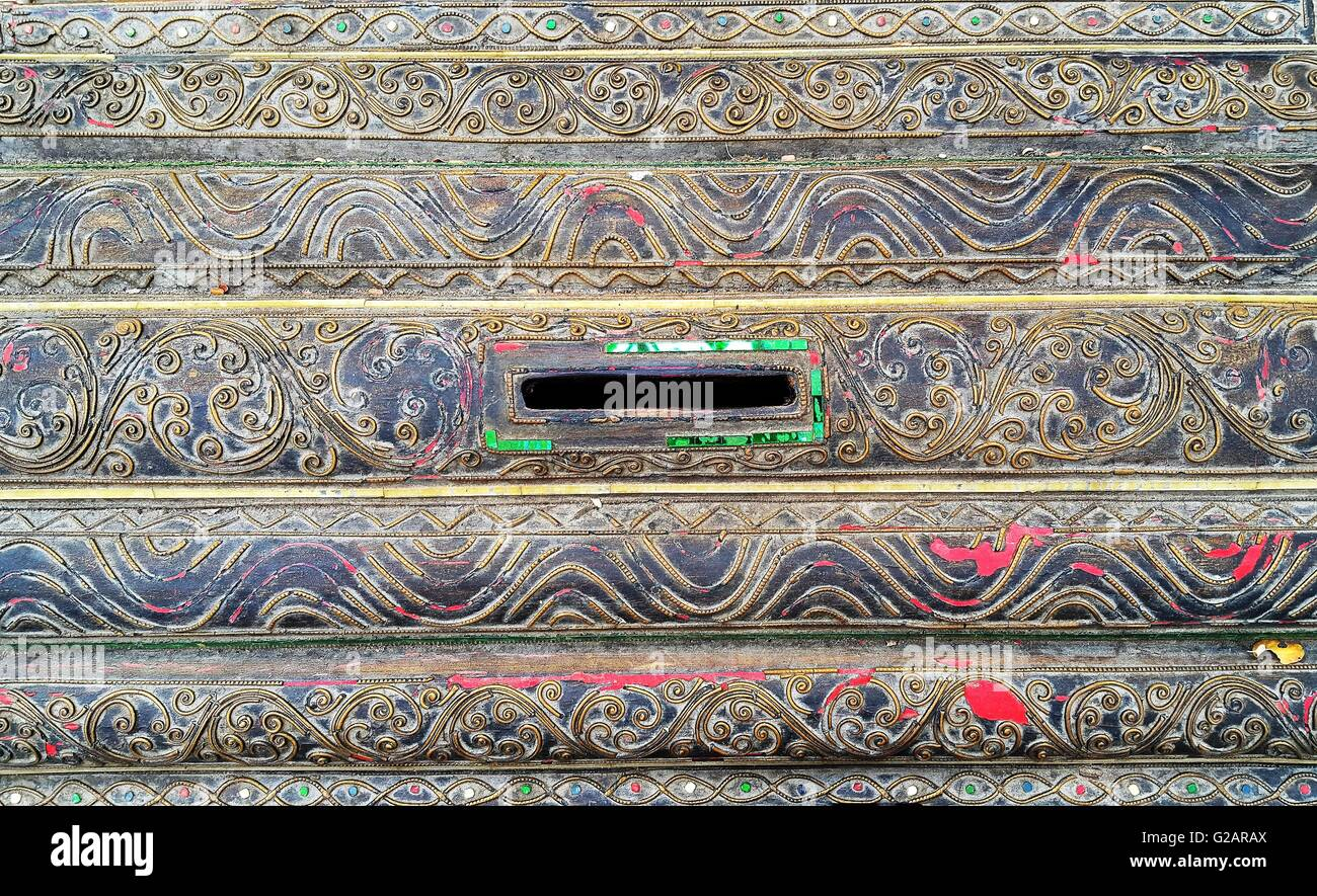 Details of ancient wooden donation box in Thai temple - Stock Image