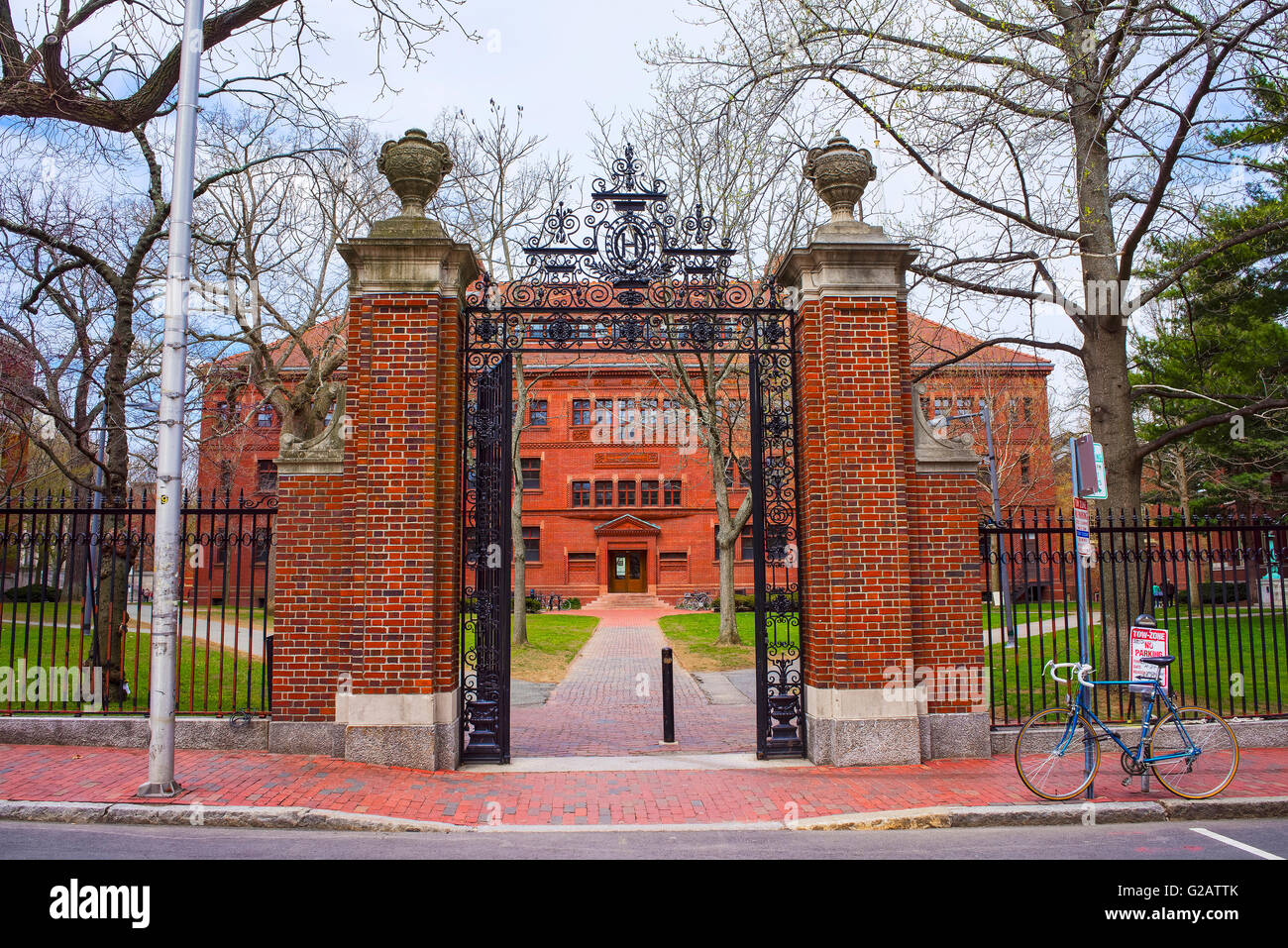 Entrance gate and East facade of Sever Hall at Harvard Yard in Harvard University in Cambridge, Massachusetts, MA, - Stock Image