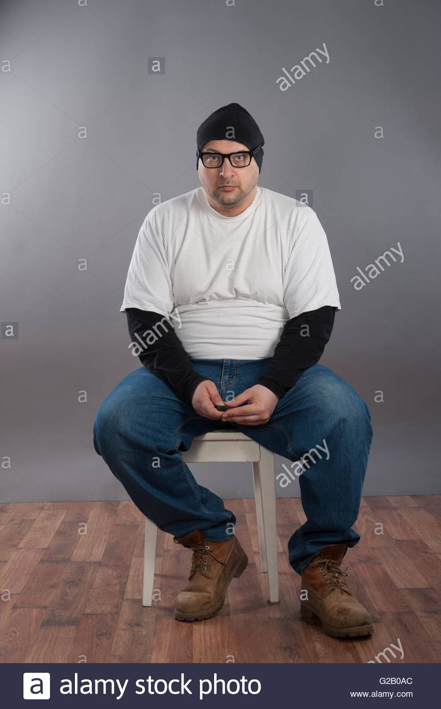 Fat Man On Chair Stock Photos & Fat Man On Chair Stock ...